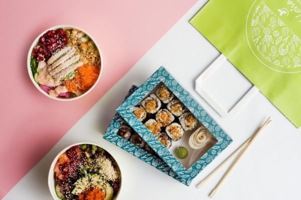 Photo of two poke bowls, a set of a maki, and chopsticks